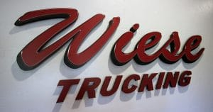 Wall sign dimensional routed logo for Wiese Trucking Inc. Lomira, Wisconsin