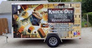 Cargo trailer wrap for Knock Out Building Restoration Fond du Lac, Wisconsin